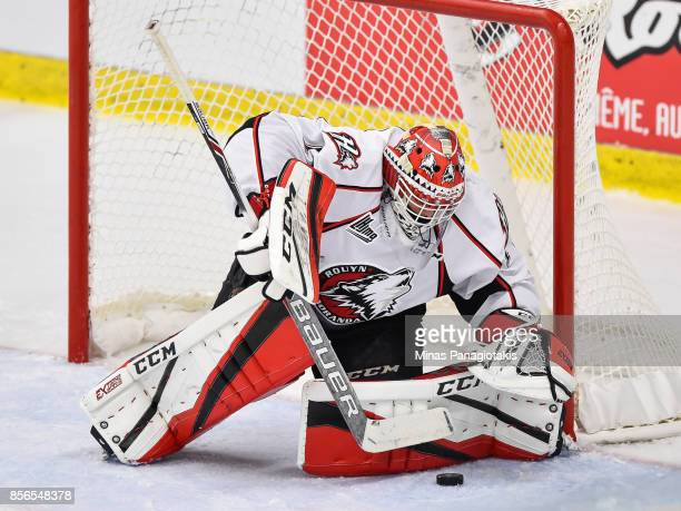 Goaltender Samuel Harvey of the Rouyn-Noranda Huskies prepares to cover the puck against the Blainville-Boisbriand Armada during the QMJHL game at...