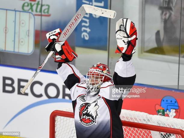 Goaltender Samuel Harvey of the Rouyn-Noranda Huskies raises his arms as he celebrates a victory against the Blainville-Boisbriand Armada during the...