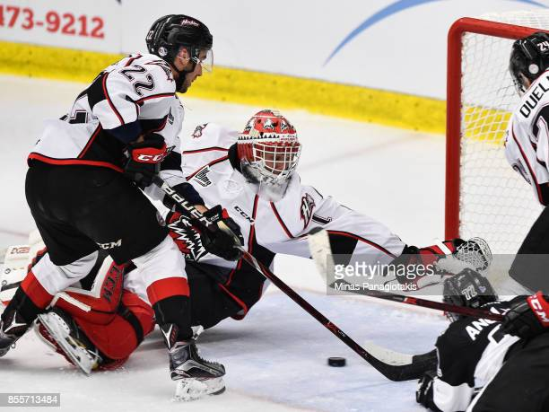Goaltender Samuel Harvey of the Rouyn-Noranda Huskies reaches out for the puck against the Blainville-Boisbriand Armada during the QMJHL game at...