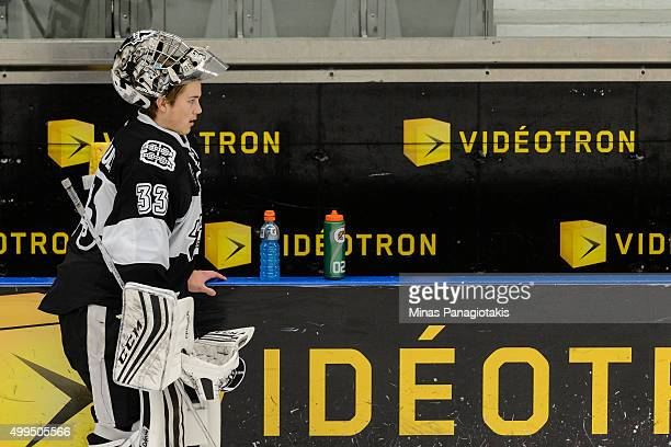 Goaltender Samuel Montembeault of the Blainville-Boisbriand Armada takes a break during the warmup prior to the QMJHL game against the Moncton...