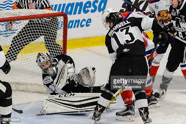 Goaltender Samuel Montembeault of the Blainville-Boisbriand Armada falls back to make the save during the QMJHL game against the Moncton Wildcats at...