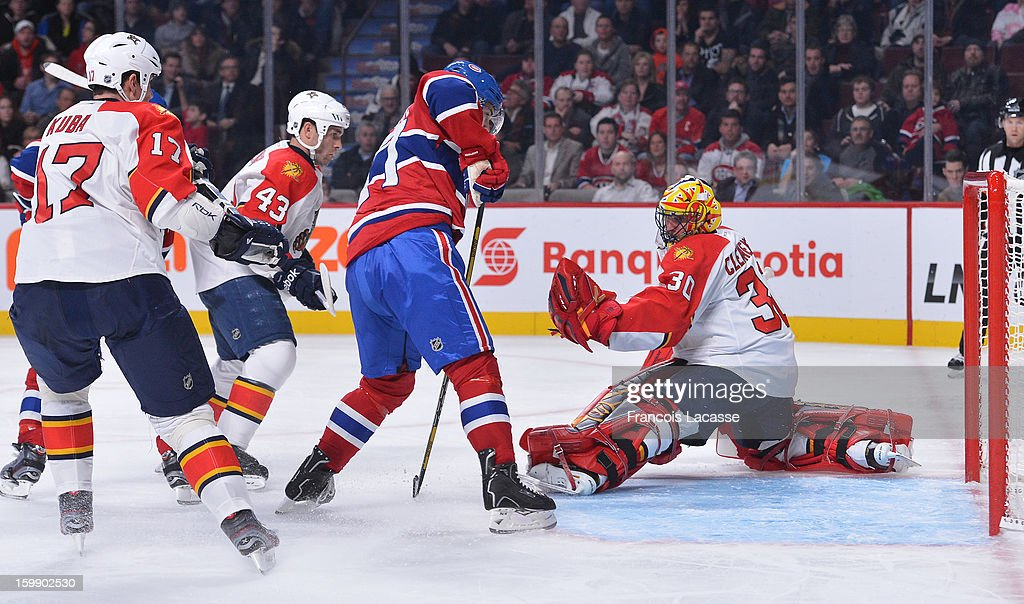Goaltender Scott Clemmensen #30 of the Florida Panthers makes a save during the NHL game against the Montreal Canadiens on January 22, 2013 at the Bell Centre in Montreal, Quebec, Canada.
