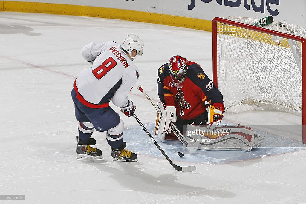 Goaltender Scott Clemmensen #30 of the Florida Panthers stops the shootout attempt by Alex Ovechkin #8 of the Washington Capitals at the BB&T Center on December 13, 2013 in Sunrise, Florida. The Panthers defeated the Capitals 3-2 in a shootout.