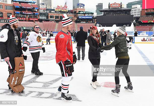 Goaltender Scott Darling left captain Jonathan Toews of the Chicago Blackhawks and guests skate during the family skate as part of the 2017...