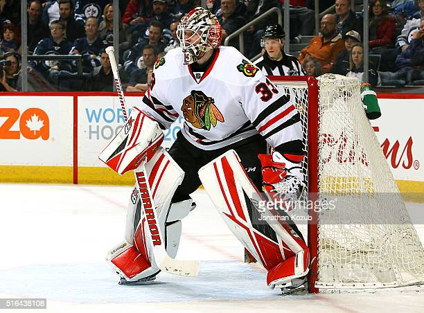 Goaltender Scott Darling of the Chicago Blackhawks guards the net during third period action against the Winnipeg Jets at the MTS Centre on March 18...