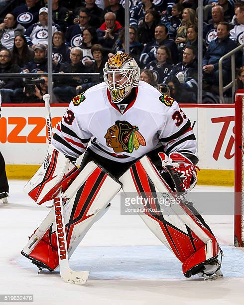 Goaltender Scott Darling of the Chicago Blackhawks guards the net during third period action against the Winnipeg Jets at the MTS Centre on April 1...