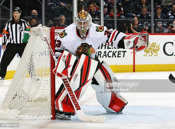 Goaltender Scott Darling of the Chicago Blackhawks keeps an eye on the play during second period action against the Winnipeg Jets at the MTS Centre...
