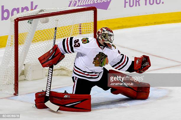 Goaltender Scott Darling of the Chicago Blackhawks makes a glove save during third period action against the Winnipeg Jets at the MTS Centre on...