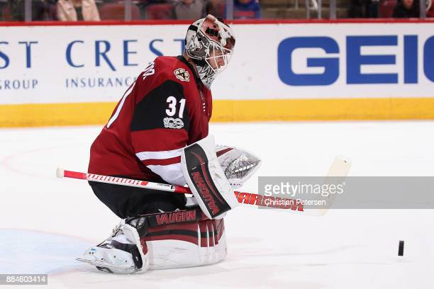Goaltender Scott Wedgewood of the Arizona Coyotes makes a save on a shot from the New Jersey Devils during the second period of the NHL game at Gila...