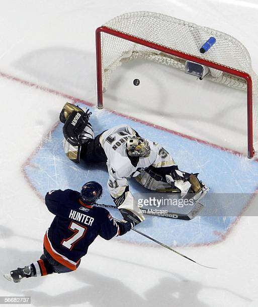 Goaltender Sebastien Caron of the Pittsburgh Penguins stops Trent Hunter of the New York Islanders during the shootout of their NHL game on January...