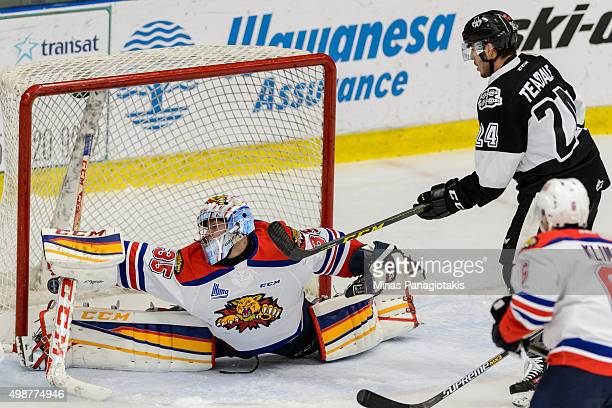 Goaltender Sebastien Dupre of the Moncton Wildcats lets in a goal on a shot by Pascal Corbeil of the Blainville-Boisbriand Armada during the QMJHL...