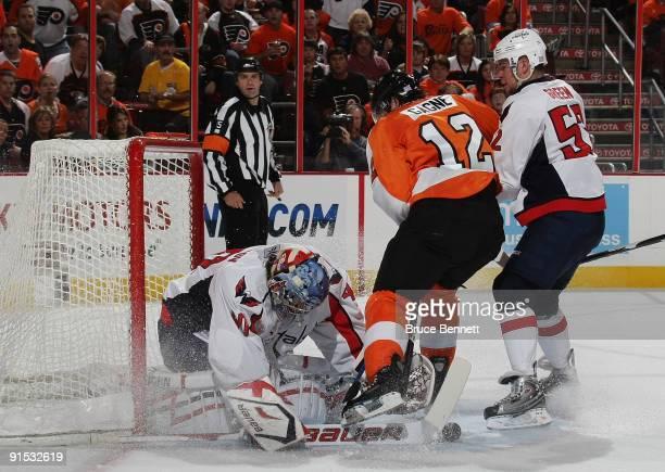 Goaltender Semyon Varlamov and defenseman Mike Green of the Washington Capitals defend against Simon Gagne of the Phildelphia Flyers at the Wachovia...