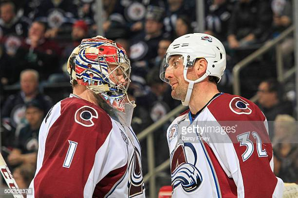 Goaltender Semyon Varlamov and Francois Beauchemin of the Colorado Avalanche chat during a third period stoppage in play against the Winnipeg Jets at...