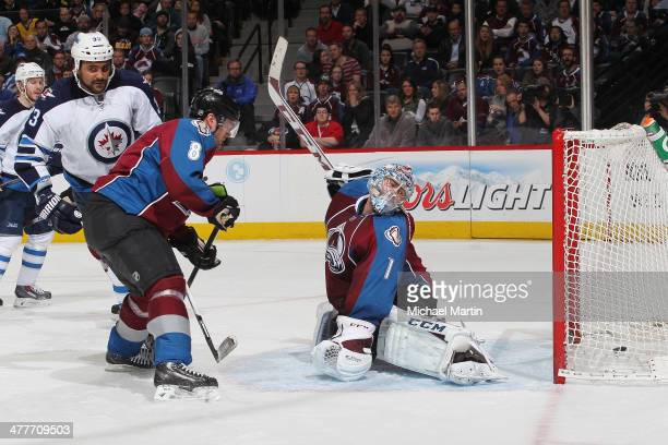 Goaltender Semyon Varlamov and Jan Hejda of the Colorado Avalanche attempt to stop a goal by Dustin Byfuglien of the Winnipeg Jets at the Pepsi...