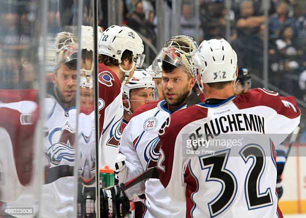 Goaltender Semyon Varlamov of the Colorado Avalanche chats with teammates Zach Redmond and Francois Beauchemin during a firstperiod stoppage in play...