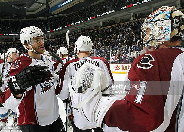 Goaltender Semyon Varlamov of the Colorado Avalanche gets congratulated by teammate Zach Redmond after backstopping the team to a 21 victory over the...