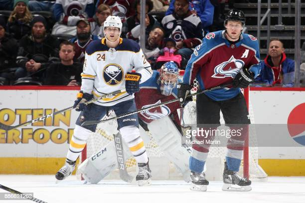 Goaltender Semyon Varlamov of the Colorado Avalanche looks past teammate Erik Johnson and Hudson Fasching of the Buffalo Sabres at the Pepsi Center...