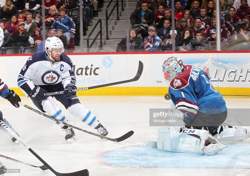 Goaltender Semyon Varlamov #1 of the Colorado Avalanche makes a save against Andrew Ladd #16 of the Winnipeg Jets at the Pepsi Center on December 29, 2013 in Denver, Colorado.