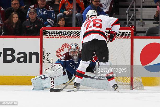 Goaltender Semyon Varlamov of the Colorado Avalanche makes a save against Patrik Elias of the New Jersey Devils during an overtime shooutout at the...