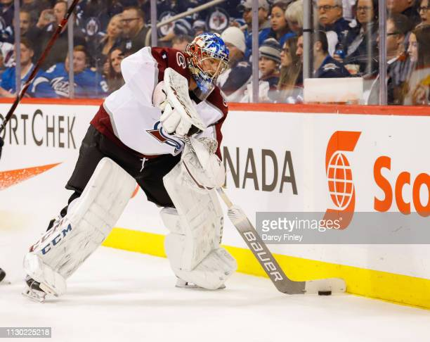 Goaltender Semyon Varlamov of the Colorado Avalanche plays the puck along the boards during third period action against the Winnipeg Jets at the Bell...