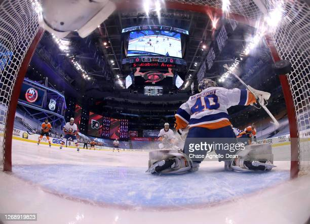Goaltender Semyon Varlamov of the New York Islanders can't make the save on a shot to the short side for a goal by Kevin Hayes of the Philadelphia...