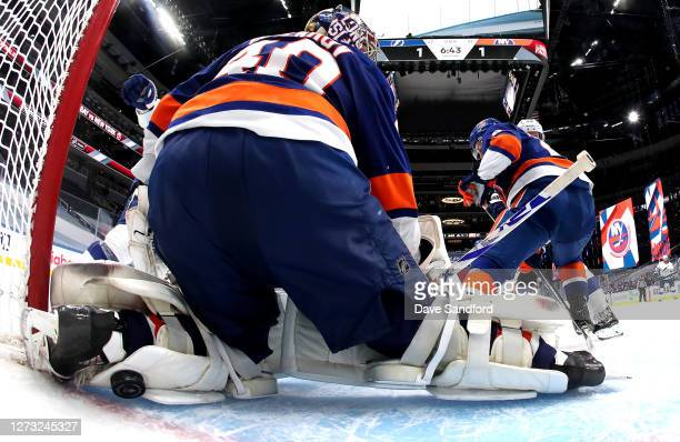 Goaltender Semyon Varlamov of the New York Islanders can't make the save on a shot for a goal by Anthony Cirelli of the Tampa Bay Lightning for the...