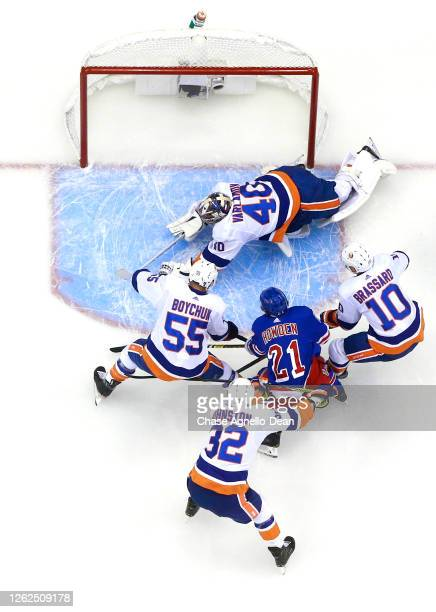 Goaltender Semyon Varlamov of the New York Islanders makes a save on Brett Howden of the New York Rangers during the exhibition game prior to the...