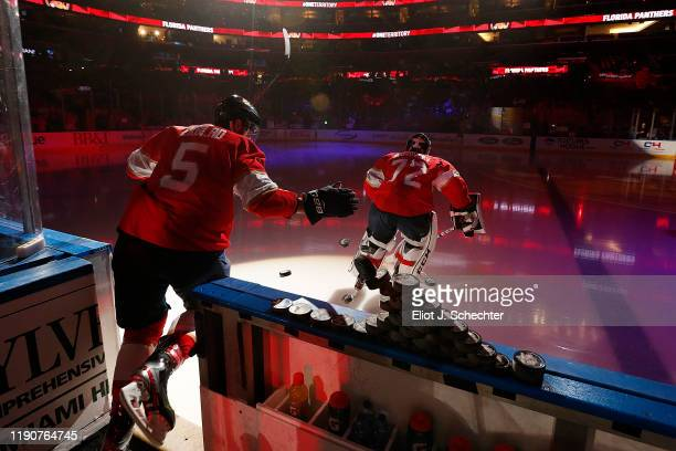 Goaltender Sergei Bobrovsky and Aaron Ekblad of the Florida Panthers head out to the ice for warm ups prior to the start of the game against the...
