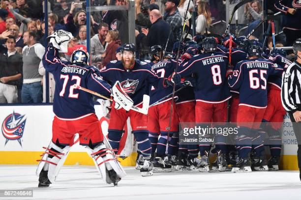 Goaltender Sergei Bobrovsky David Savard and the rest of the Columbus Blue Jackets celebrate after defeating the Winnipeg Jets 21 in overtime on...