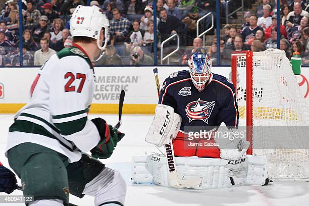 Goaltender Sergei Bobrovsky of the Columbus Blue Jackets blocks a back-hand shot by Brett Sutter of the Minnesota Wild during the second period on...