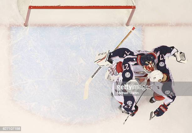 Goaltender Sergei Bobrovsky of the Columbus Blue Jackets celebrates a win against the Colorado Avalanche with teammates Ryan Murray and Brandon...