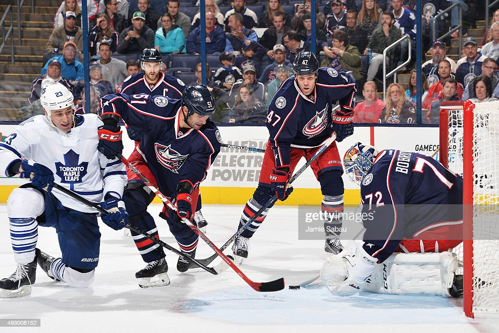 Goaltender Sergei Bobrovsky #72 of the Columbus Blue Jackets defends the net as Shawn Matthias #23 of the Toronto Maple Leafs and Fedor Tyutin #51 of the Columbus Blue Jackets battle for position during the second period on October 16, 2015 at Nationwide Arena in Columbus, Ohio.