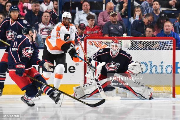 Goaltender Sergei Bobrovsky of the Columbus Blue Jackets defends the net as Matt Calvert of the Columbus Blue Jackets turns to avoid the puck during...