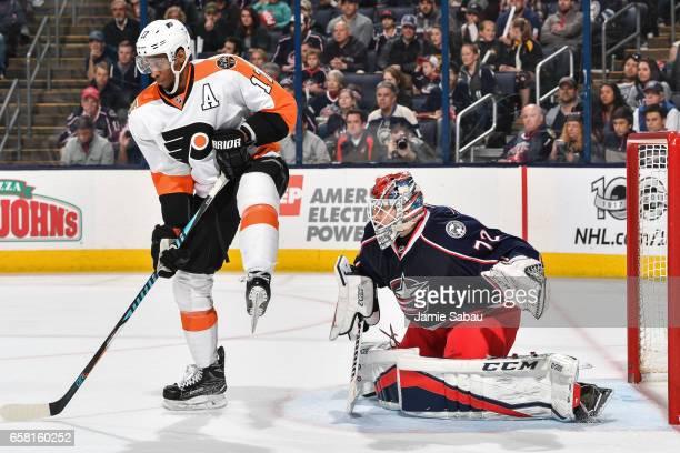 Goaltender Sergei Bobrovsky of the Columbus Blue Jackets defends the net as Wayne Simmonds of the Philadelphia Flyers skates by on March 25 2017 at...