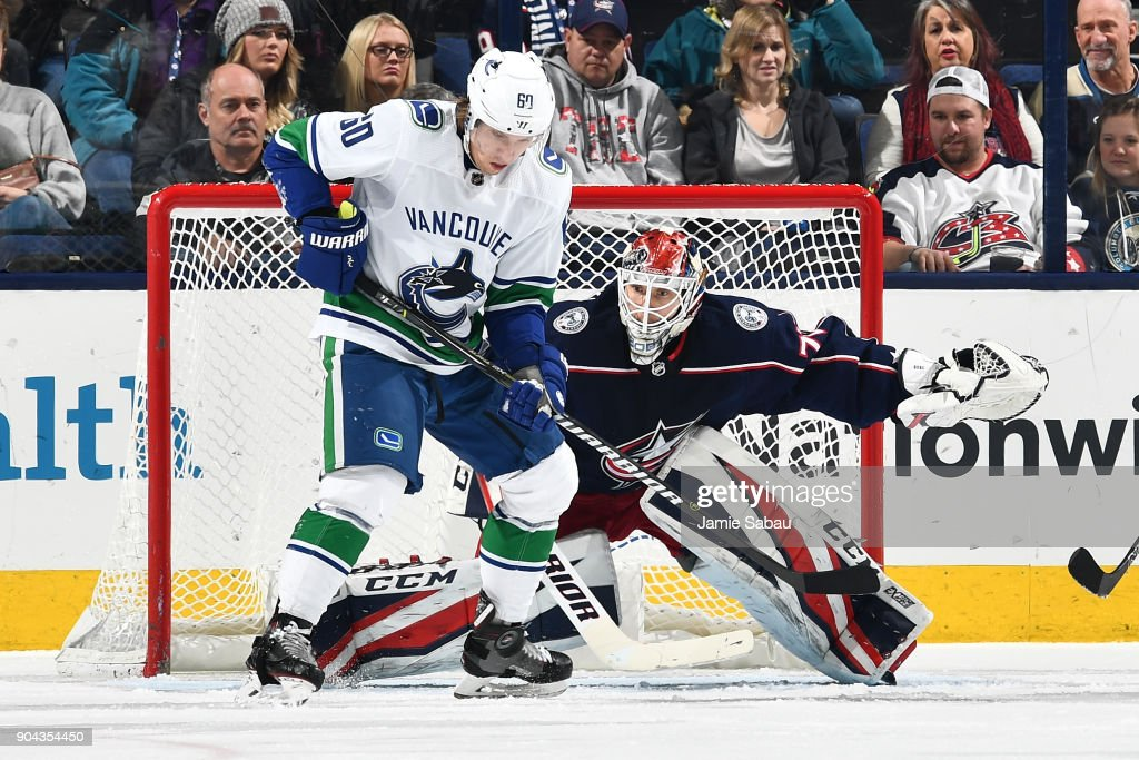 Goaltender Sergei Bobrovsky #72 of the Columbus Blue Jackets defends the net as Markus Granlund #60 of the Vancouver Canucks follows a loose puck during the third period of a game on January 12, 2018 at Nationwide Arena in Columbus, Ohio.