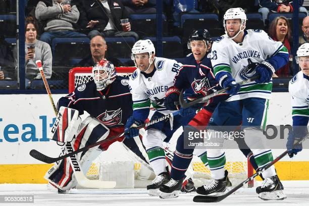 Goaltender Sergei Bobrovsky of the Columbus Blue Jackets defends the net as Sam Gagner of the Vancouver Canucks Jack Johnson of the Columbus Blue...