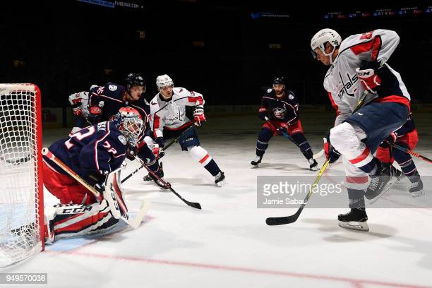 Goaltender Sergei Bobrovsky of the Columbus Blue Jackets defends the net against Jay Beagle of the Washington Capitals in Game Four of the Eastern...