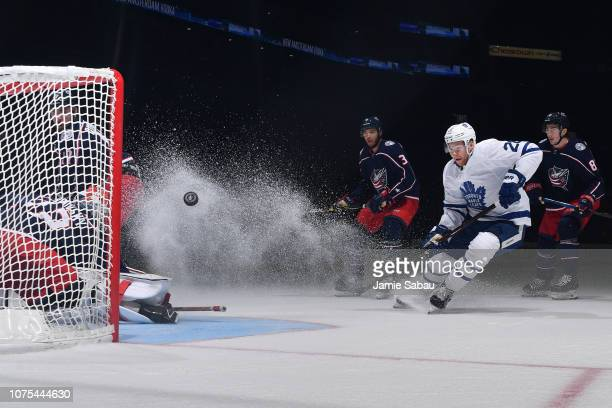 Goaltender Sergei Bobrovsky of the Columbus Blue Jackets deflects a shot taken by Connor Brown of the Toronto Maple Leafs during the second period of...