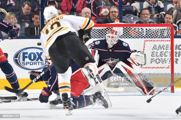 Goaltender Sergei Bobrovsky of the Columbus Blue Jackets follows a shot taken by Kenny Agostino of the Boston Bruins during the third period of a...