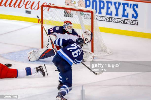 Goaltender Sergei Bobrovsky of the Columbus Blue Jackets makes a glove save on a shot by Blake Wheeler of the Winnipeg Jets during second period...