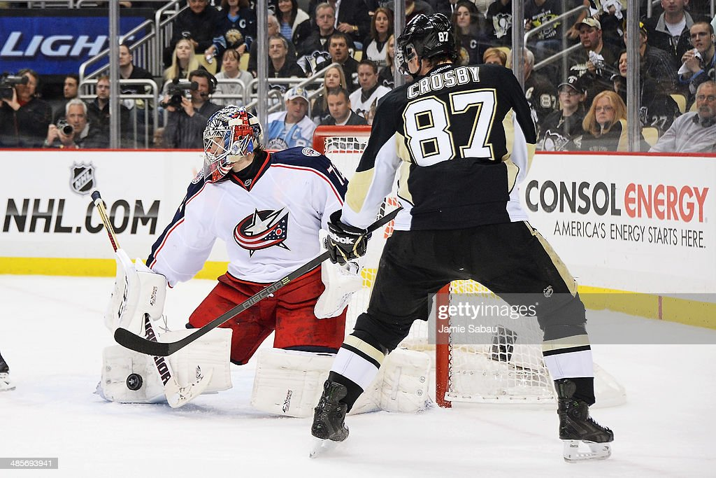Goaltender Sergei Bobrovsky #72 of the Columbus Blue Jackets makes a pad save off a shot from Sidney Crosby #87 of the Pittsburgh Penguins in the first overtime in Game Two of the First Round of the 2014 NHL Stanley Cup Playoffs on April 19, 2014 at CONSOL Energy Center in Pittsburgh, Pennsylvania. Columbus defeated Pittsburgh 4-3 in the second overtime to capture the franchise's first playoff win.