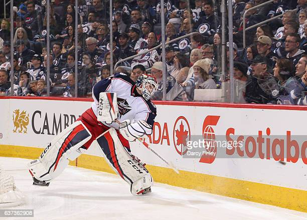Goaltender Sergei Bobrovsky of the Columbus Blue Jackets plays the puck along the boards during third period action against the Winnipeg Jets at the...