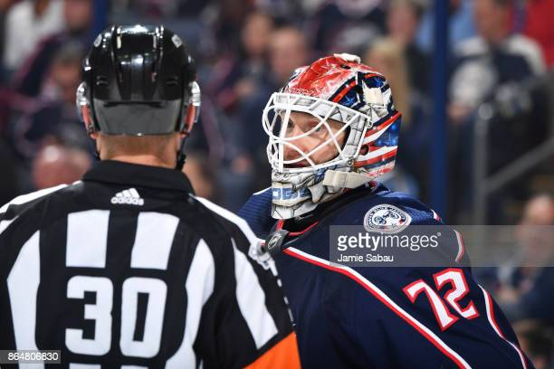 Goaltender Sergei Bobrovsky of the Columbus Blue Jackets talks with referee Kendrick Nicholson during the second period of a game against the Los...