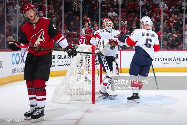 Goaltender Sergei Bobrovsky of the Florida Panthers celebrates with Anton Stralman after defeating the Arizona Coyotes in the NHL game at Gila River...