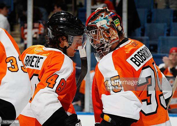Goaltender Sergei Bobrovsky of the Philadelphia Flyers and teammate Danny Briere celebrate their victory against the New York Islanders on December 5...