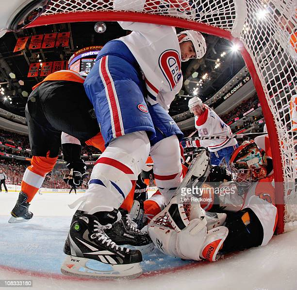 Goaltender Sergei Bobrovsky of the Philadelphia Flyers keeps the puck under him amidst a scrum of players in his crease in his game against the...