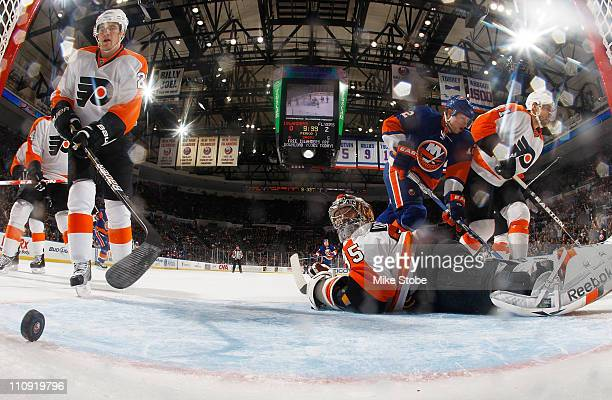 Goaltender Sergei Bobrovsky of the Philadelphia Flyers looks behind him at the goal scored by Blake Comeau of the New York Islanders on March 26 2011...