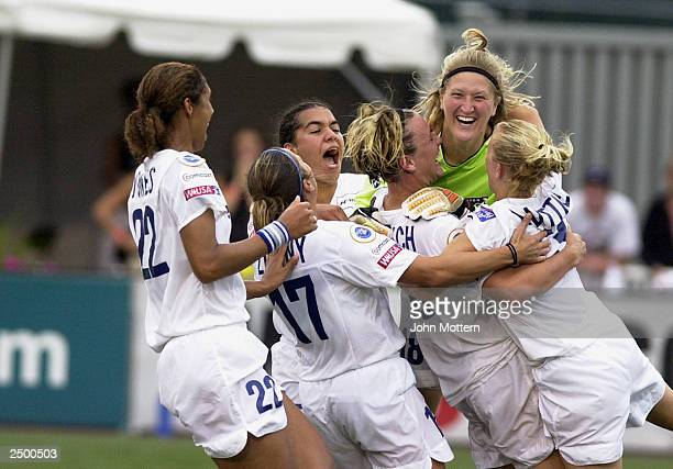 Goaltender Siri Mullinix of the Washington Freedom is cheered by her team as they defeat the Boston Breakers in double overtime in the WUSA...