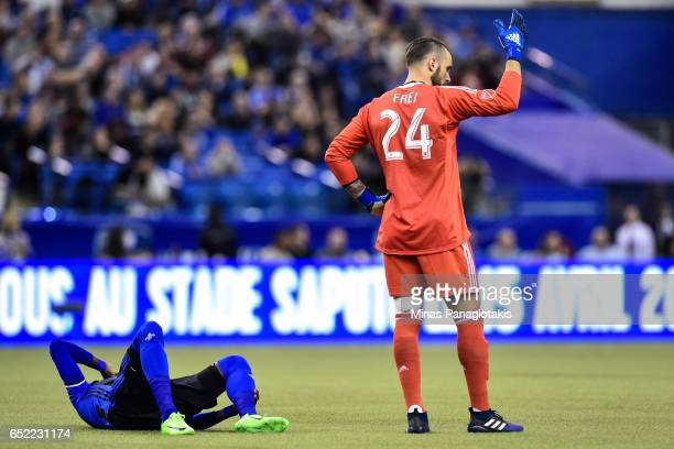 Goaltender Stefan Frei of the Seattle Sounders calls for a help for Ambroise Oyongo of the Montreal Impact as he lays hurt on the pitch during the...
