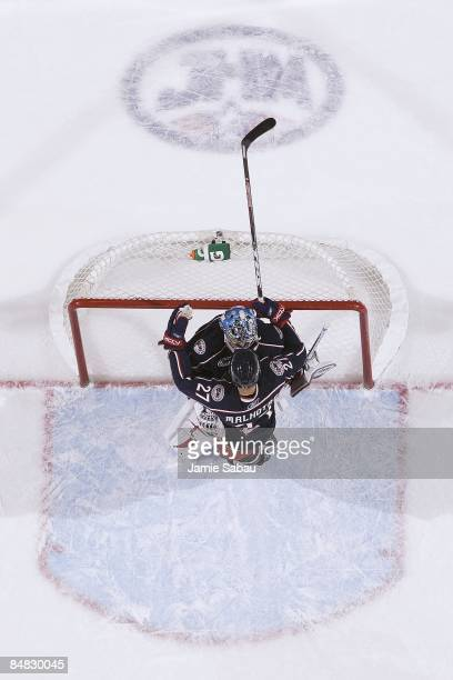 Goaltender Steve Mason of the Columbus Blue Jackets is congratulated by forward Manny Malhotra of the Blue Jackets after posting a 3-2 win over the...